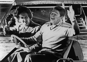 Ronald Reagan (R) and Margaret Thatcher wave after